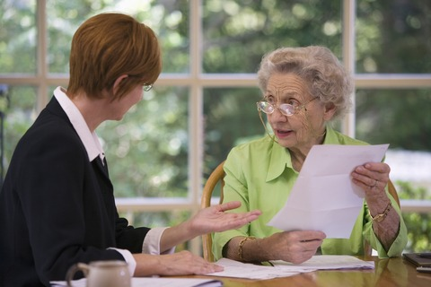 Advisor talking to elderly client
