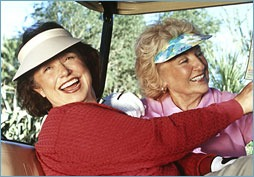 Ladies in golf cart
